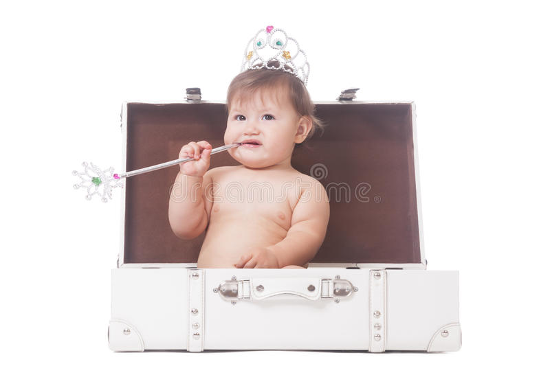 Young pageant queen. Young adorable pageant queen sitting in the case stock image