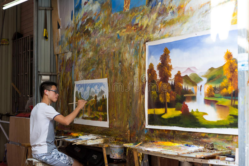 Young painter painting picture stock photos
