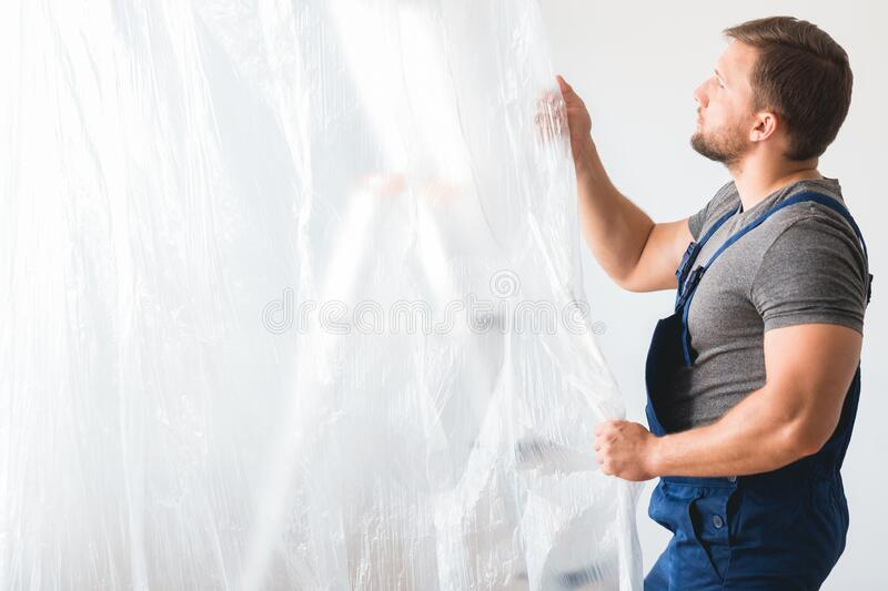 Painter securing the room royalty free stock photo