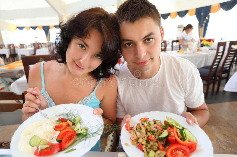 Download Young Pair In Cafe With Plates With Salad Stock Photo - Image of casual, hotel: 10698994