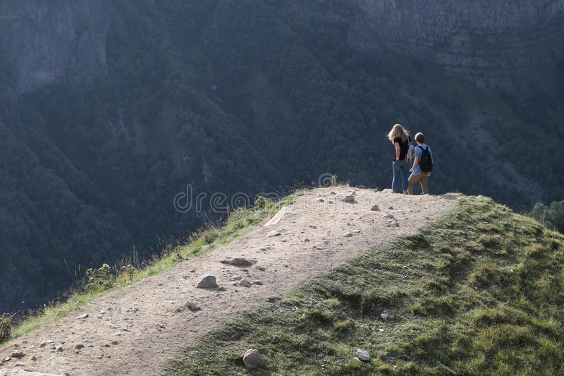 Young pair on Caucasian mountain. In Georgia royalty free stock images