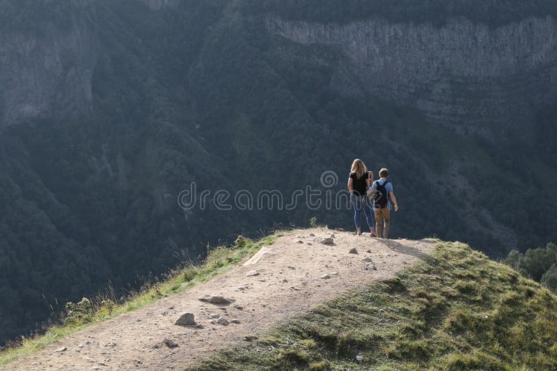 Young pair on Caucasian mountain. In Georgia stock images