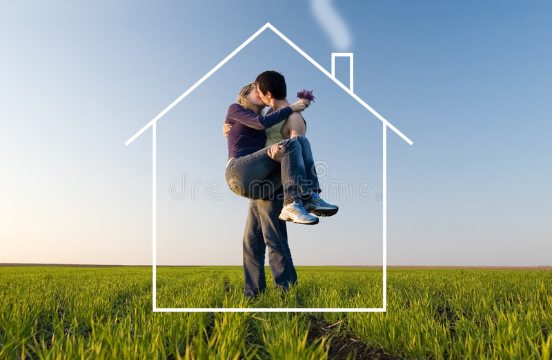 The young pair kisses and dreams about the house stock photo