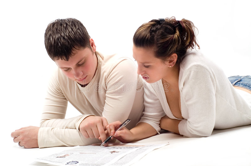 Download Young Pair And The Newspaper Stock Photo - Image: 7915238