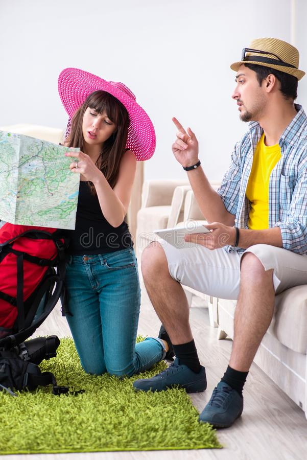 The young pair planning their honeymoon camping trip royalty free stock images