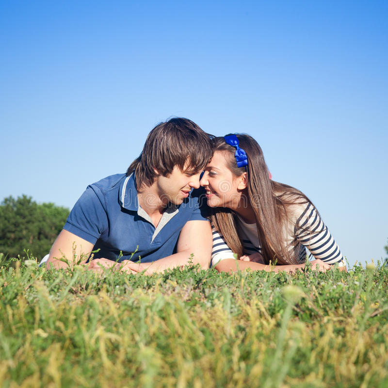 Young Pair Relax In Park Stock Images