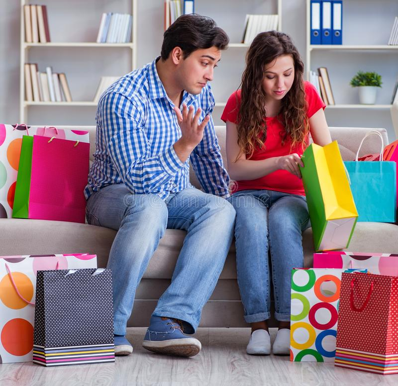 Young pair after shopping with many bags stock photos