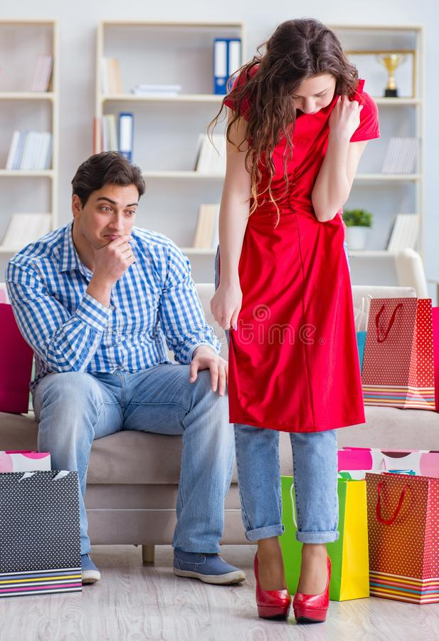 Young pair after shopping with many bags royalty free stock photography
