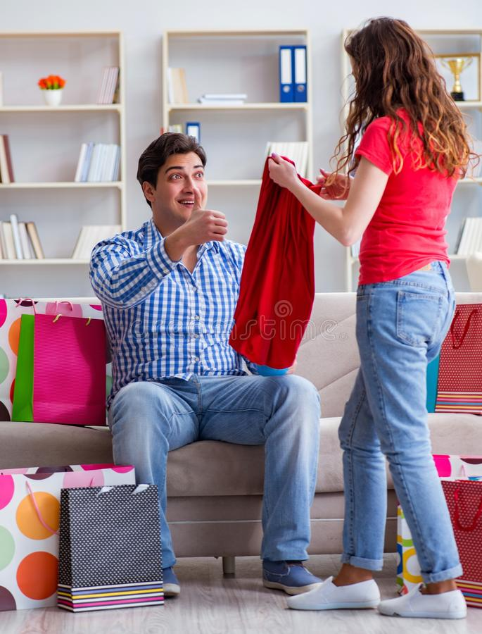 Young pair after shopping with many bags stock photo