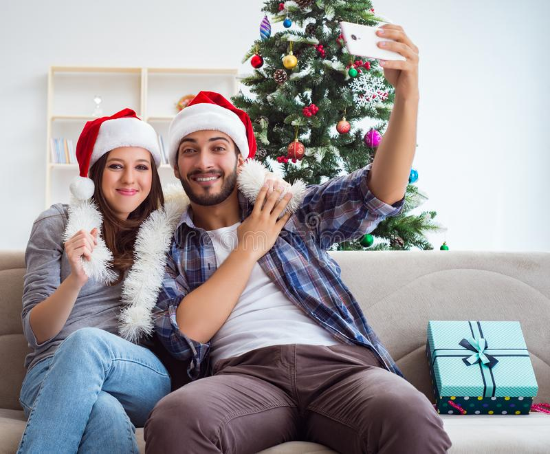 Young pair taking selfies during christmas stock image