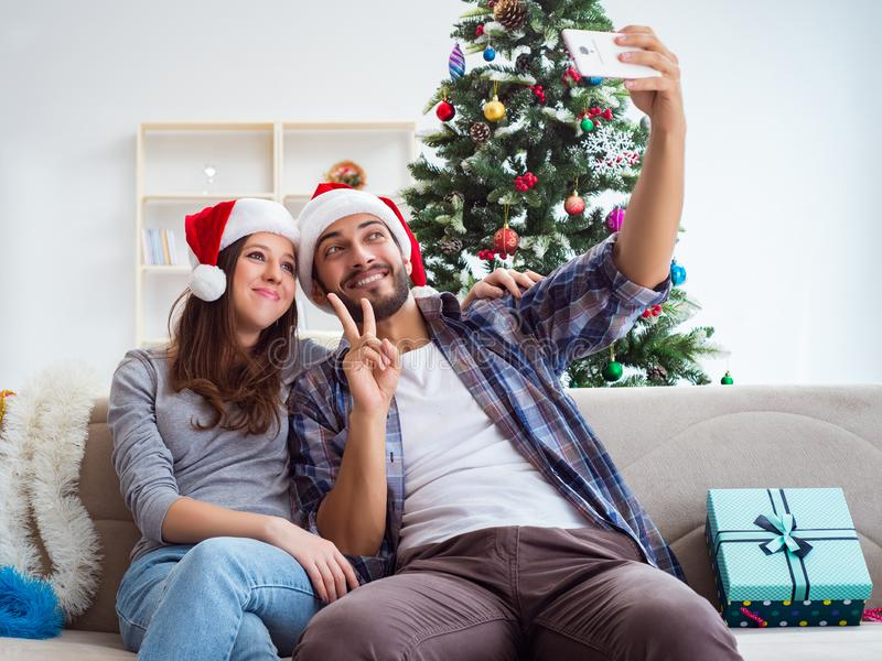 Young pair taking selfies during christmas. The young pair taking selfies during christmas stock images