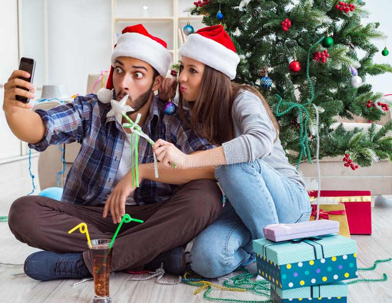 Young pair taking selfies during christmas royalty free stock photos