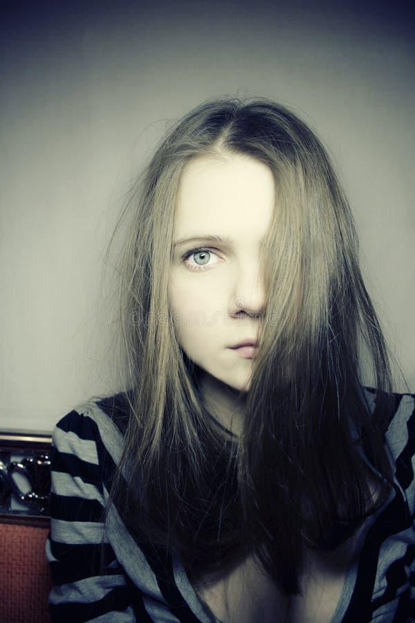 Young pale sad girl