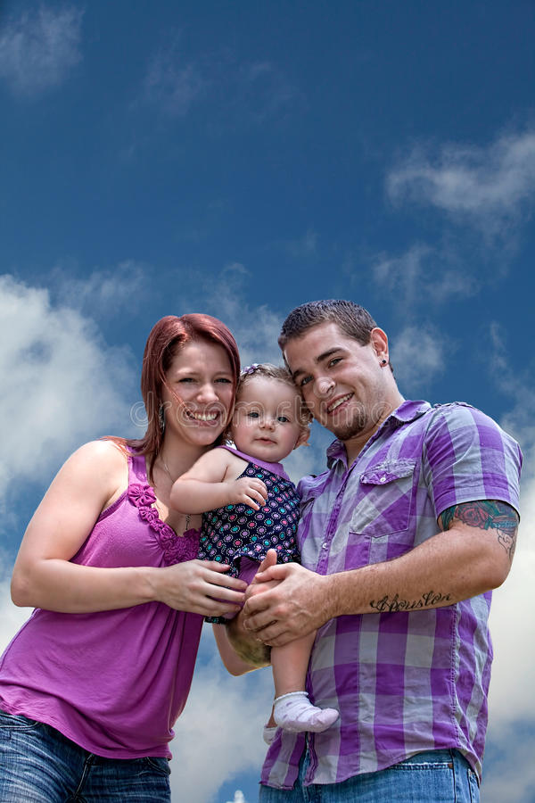 Young parents and baby girl royalty free stock image