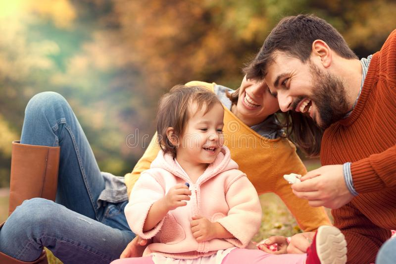 Young parents having fun with their little daughter stock images