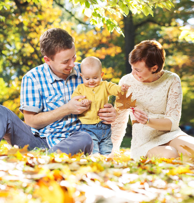 Young parents playing with baby royalty free stock photos