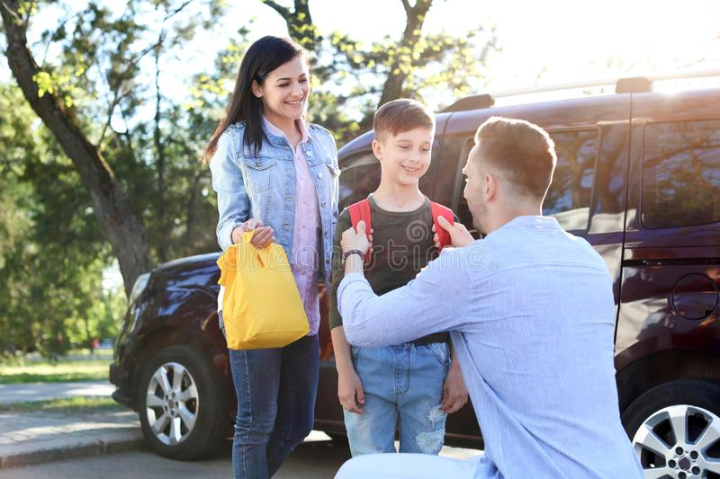 Young parents saying goodbye to their little child stock image