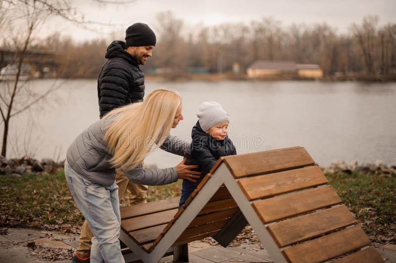 Young parents walking with a little son royalty free stock images
