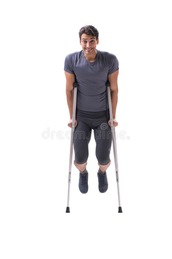 Young patient athlete sportsman suffering an injury trauma with. Crutches isolated on white stock photos