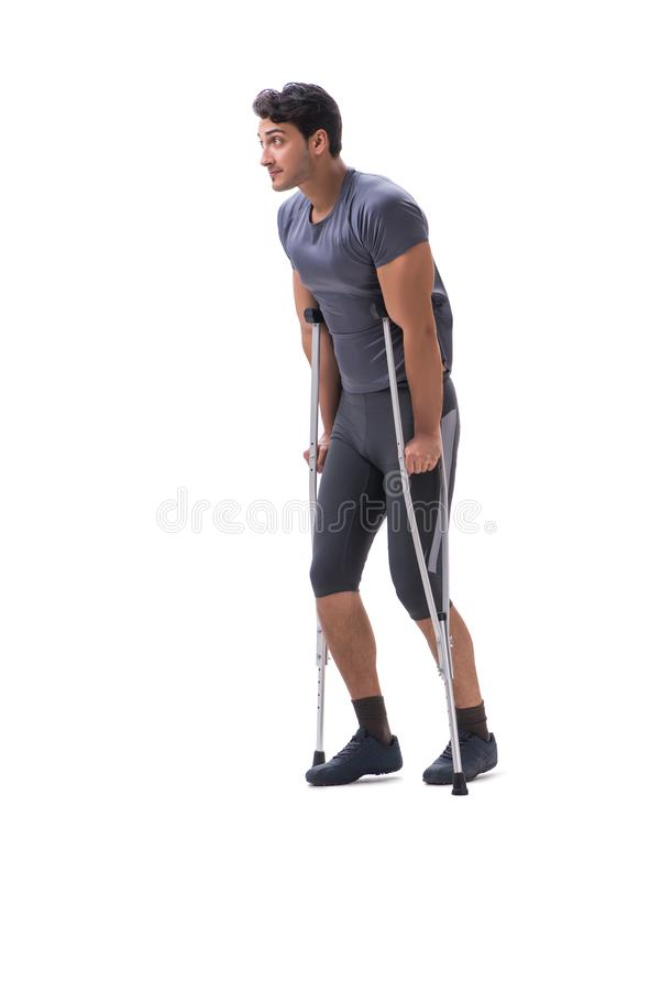 Young patient athlete sportsman suffering an injury trauma with. Crutches isolated on white stock images