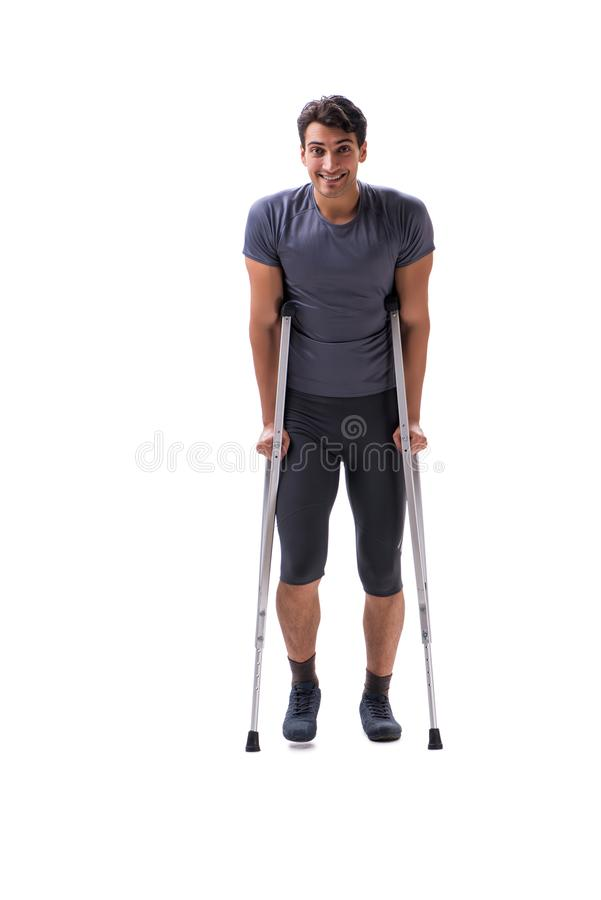 Young patient athlete sportsman suffering an injury trauma with. Crutches isolated on white royalty free stock images