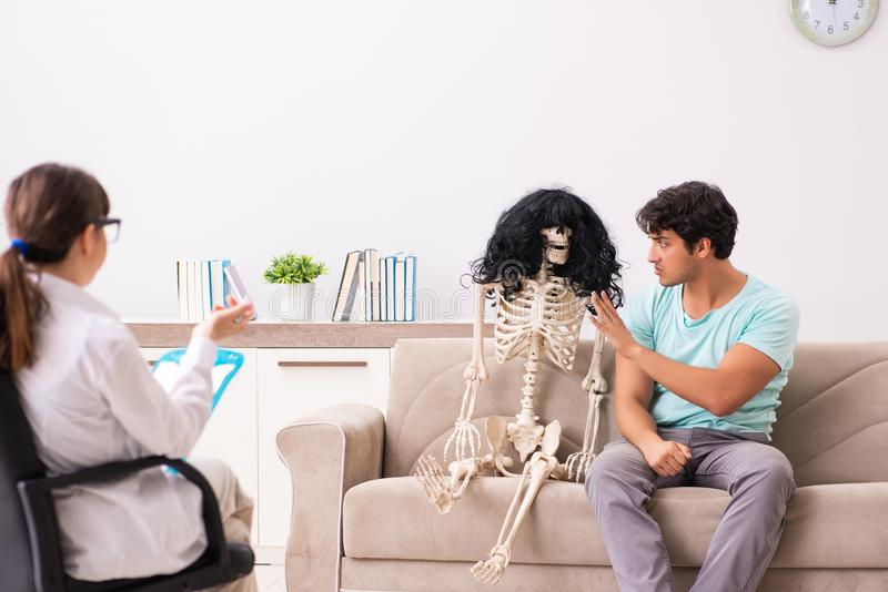 The young patient visiting psychologist for therapy stock image