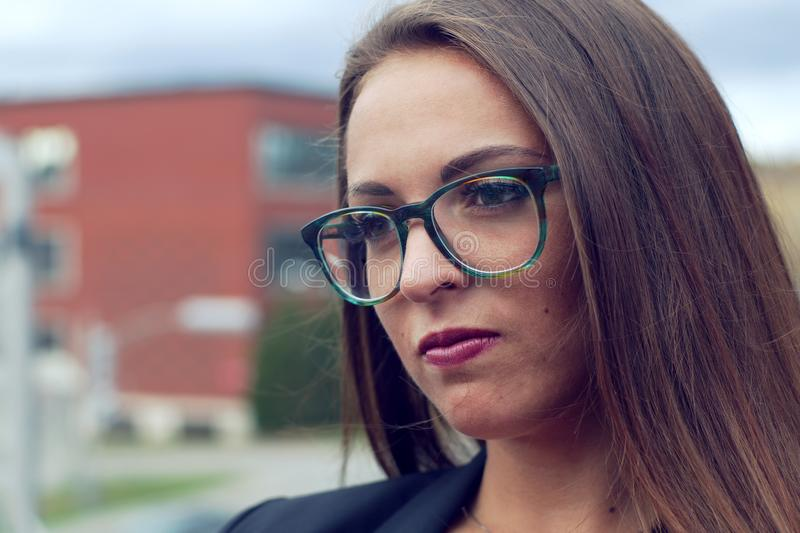 Young pensive businesswoman glasses outside stock images
