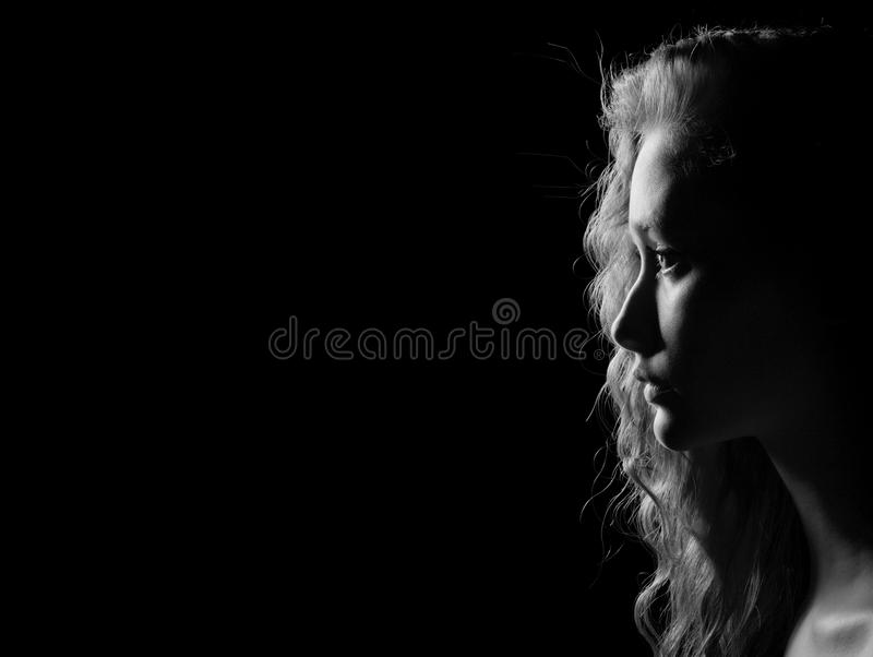 Young pensive woman stock image