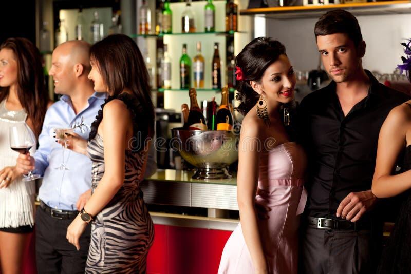 Young people at bar counter royalty free stock photos