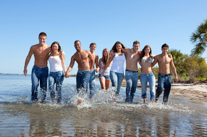 Young people at the beach stock photography