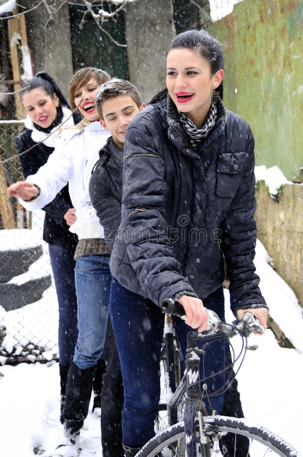 Young people on bicycle in winter season royalty free stock photography