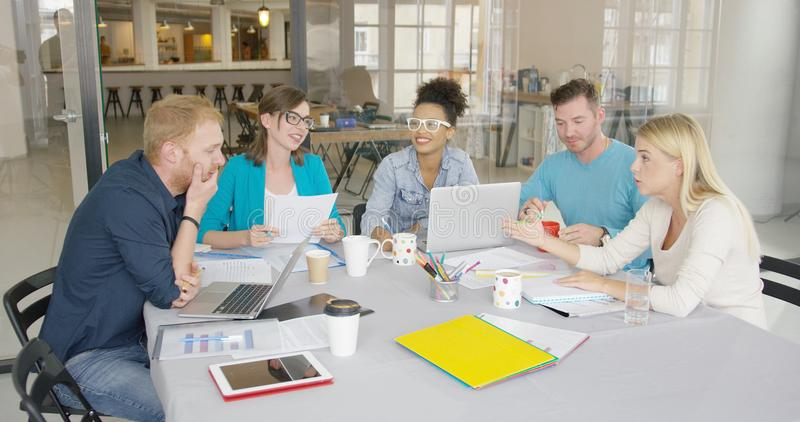 Young people brainstorming in office stock photo