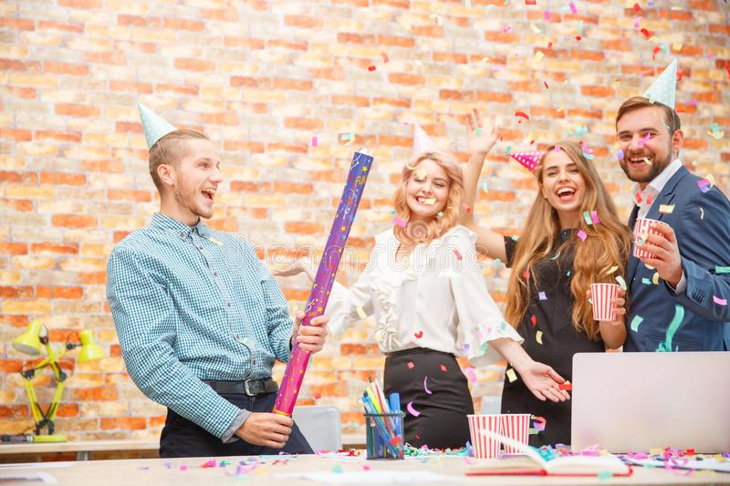 Young people celebrate something at a corporate party in the office royalty free stock photos