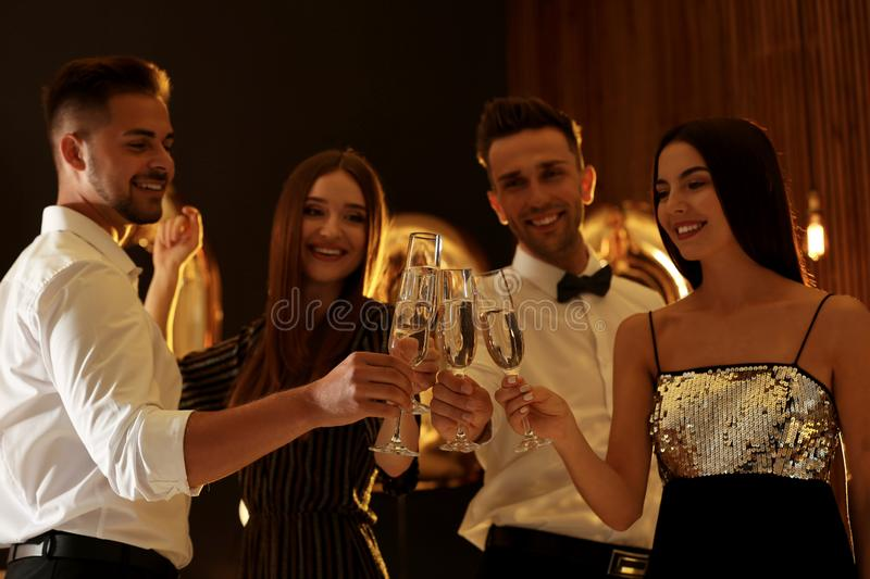 Young people celebrating New Year stock images