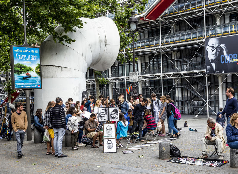 Young people at centre pompidou have fun being drawed by artists. PARIS, FRANCE - JUNE 9, 2015: young people at centre pompidou have fun being drawed by artists stock photos