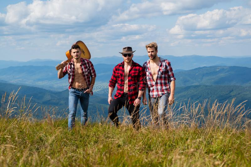 Young people on country walk. Young people on mountain hike. Goal success freedom and achievement concept. Camping and stock image