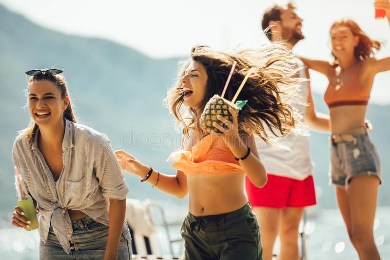 Young people dancing at the beach and having fun royalty free stock image