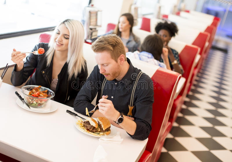 Young people in diner. View of the people meeting in the diner royalty free stock image