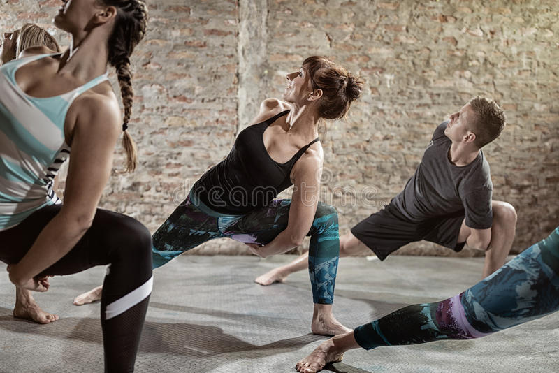 Young people doing flexibility exercise stock photo