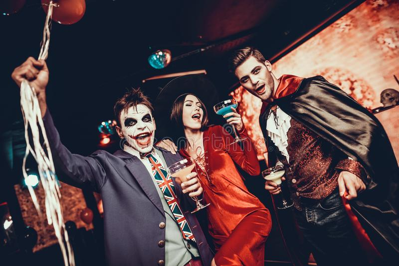Young People Drinking Cocktails at Halloween Party royalty free stock photo