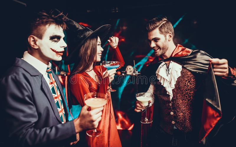 Young People Drinking Cocktails at Halloween Party royalty free stock photos