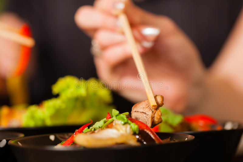 Young People Eating In Thai Restaurant Stock Photos