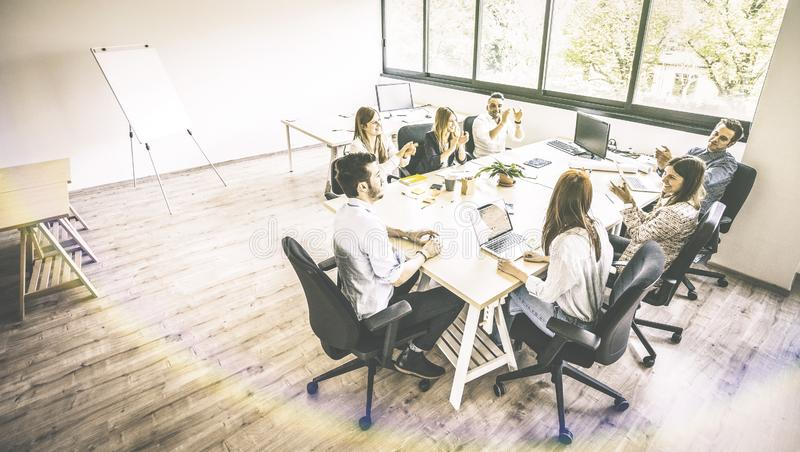 Young people employee coworkers at business meeting in urban coworker space start up stock photos