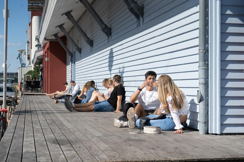 Young people enjoying good weather outdoors in the old port district royalty free stock image