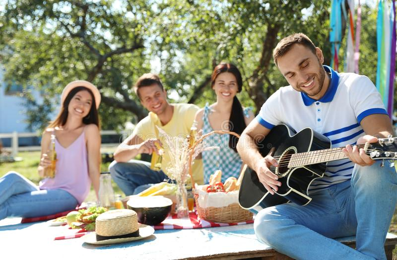 Young people enjoying picnic on summer day stock photos