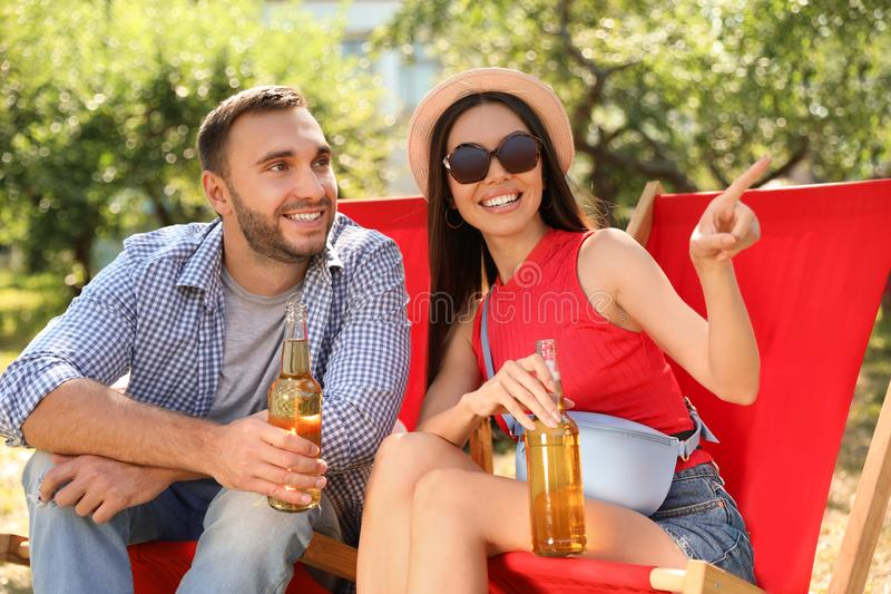 Young people enjoying picnic  on summer day royalty free stock image