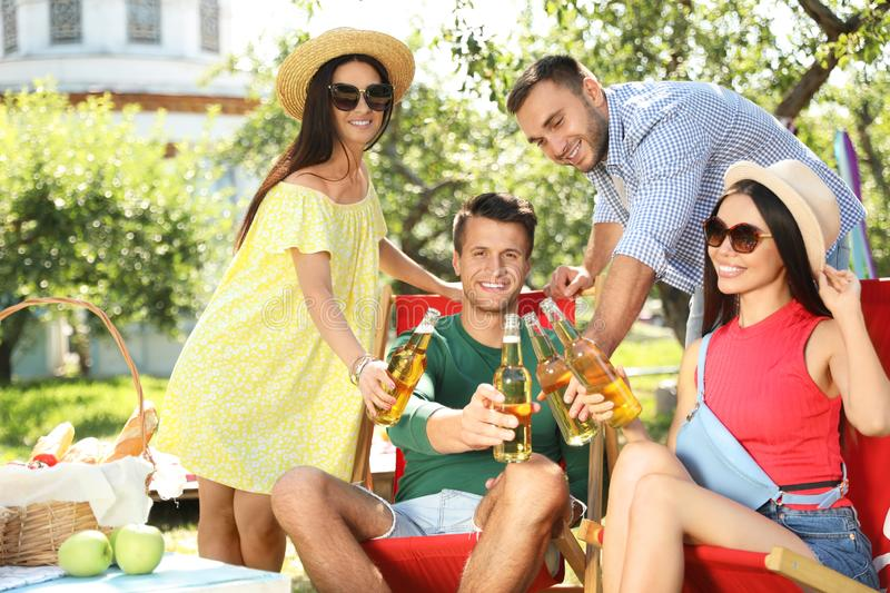 Young people enjoying picnic on summer day royalty free stock photo