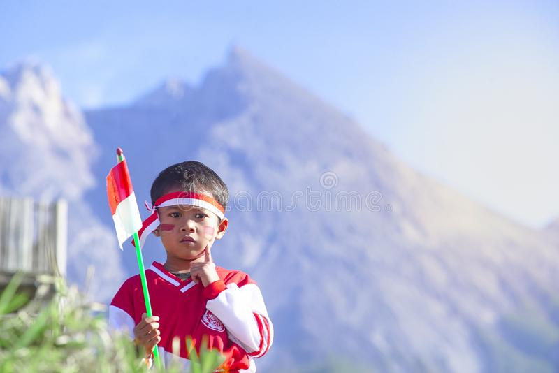 Young People with Flag. Indonesia Flag, Indonesia Independance Day with mt Merapi background stock photography