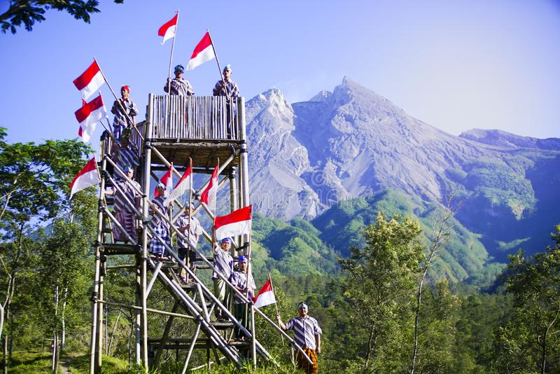 Young People with Flag. Indonesia Flag, Indonesia Independance Day with mt Merapi background royalty free stock photo
