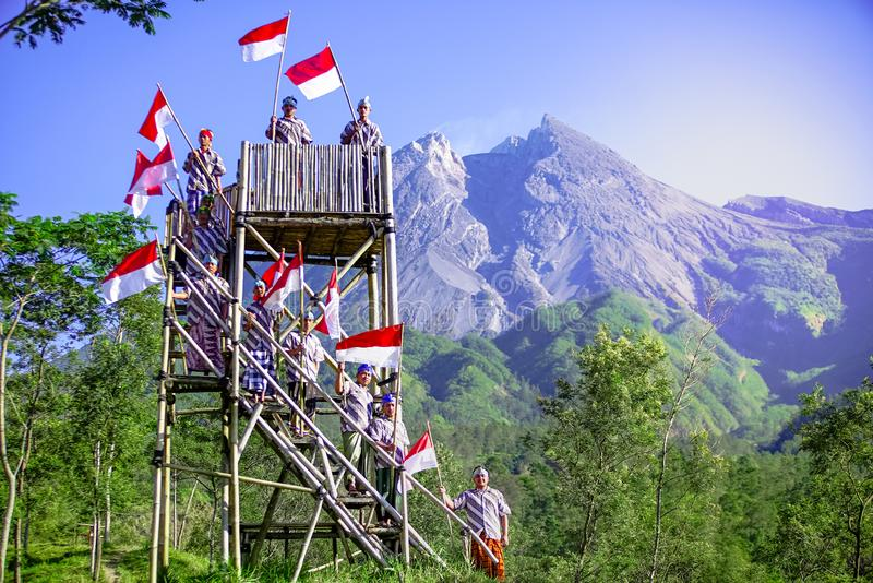 Young People with Flag. Indonesia Flag, Indonesia Independance Day with mt Merapi background stock photo